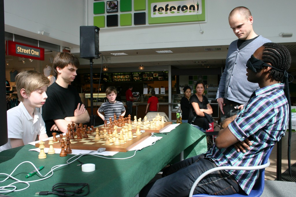 Blindfold Simul At Ikano-Huset Linköping,Sweden against Sven Risberg and Martin Bengtson with Referee Martin Klashed transfering the moves
